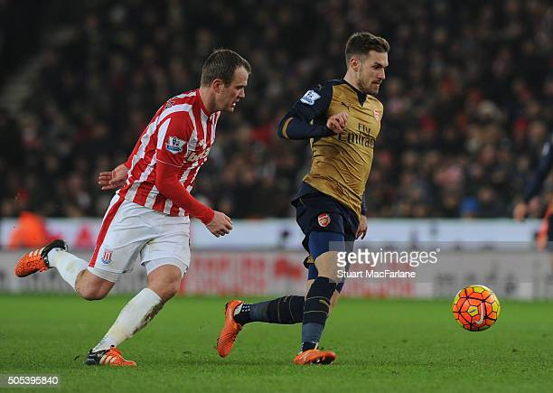 Aaron Ramsey of Arsenal takes on Glen Whelan of Stoke during the Barclays Premier League match between Stoke City and Arsenal at the Britannia...