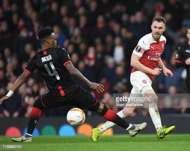 Aaron Ramsey of Arsenal takes on Mexer of Rennes during the UEFA Europa League Round of 16 Second Leg match between Arsenal and Stade Rennais at...