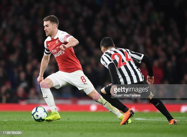 Aaron Ramsey of Arsenal takes on Miguel Almiron of Newcastle during the Premier League match between Arsenal FC and Newcastle United at Emirates...