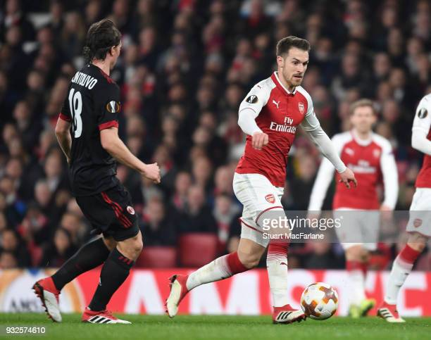Aaron Ramsey of Arsenal takes on Riccardo Montolivo of Milan during UEFA Europa League Round of 16 match between AC Milan and Arsenal at Emirates...