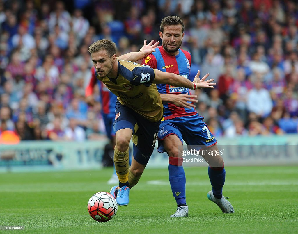 Aaron Ramsey (L) of Arsenal takes on Yohan Cabaye of Crystal Palace during the Barclays Premier League match between Crystal Palace and Arsenal on August 16, 2015 in London, United Kingdom.