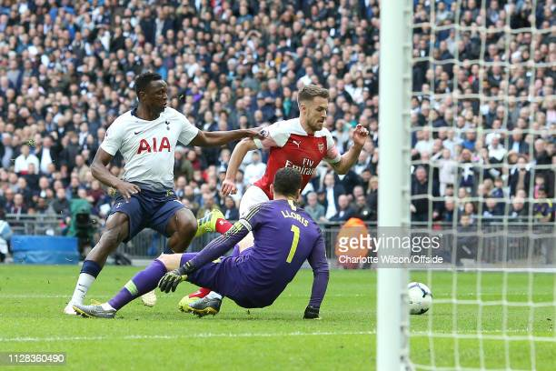 Aaron Ramsey of Arsenal takes the ball round Victor Wanyama of Tottenham and Tottenham goalkeeper Hugo Lloris to score the opening goal during the...