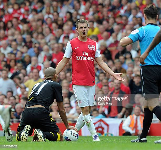 Aaron Ramsey of Arsenal talks to the referee after fouling Darren Pratley of Bolton during the Barclays Premier League match between Arsenal and...