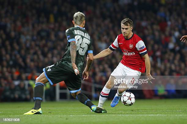 Aaron Ramsey of Arsenal vies with Valon Behrami of Napoli during the UEFA Champions League Group F soccer match between Arsenal FC and SSC Napoli at...