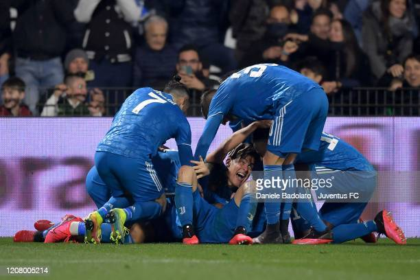 Aaron Ramsey of Juventus celebrates with teammates after scoring the 0-2 goal during the Serie A match between SPAL and Juventus at Stadio Paolo...