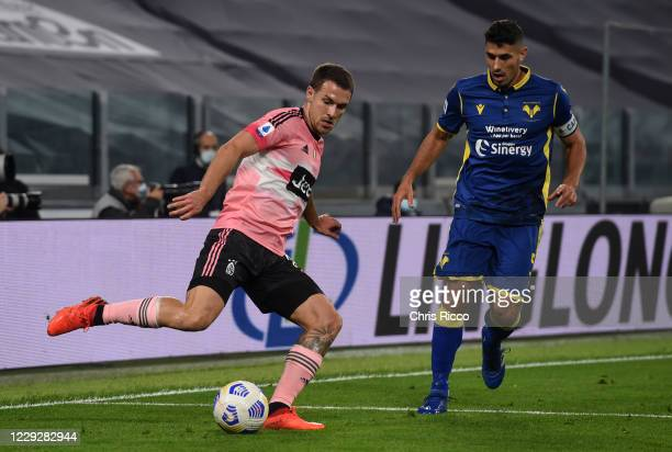 Aaron Ramsey of Juventus challenged by Davide Faraoni of Hellas Verona during the Serie A match between Juventus and Hellas Verona FC at Allianz...
