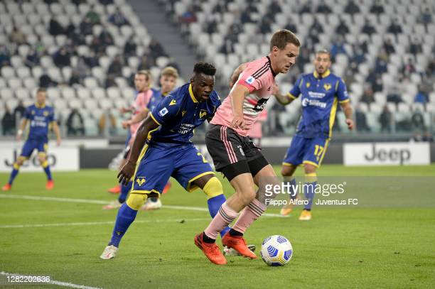 Aaron Ramsey of Juventus competes for the ball with Ronaldo Vieira of Hellas Verona FC during the Serie A match between Juventus and Hellas Verona FC...