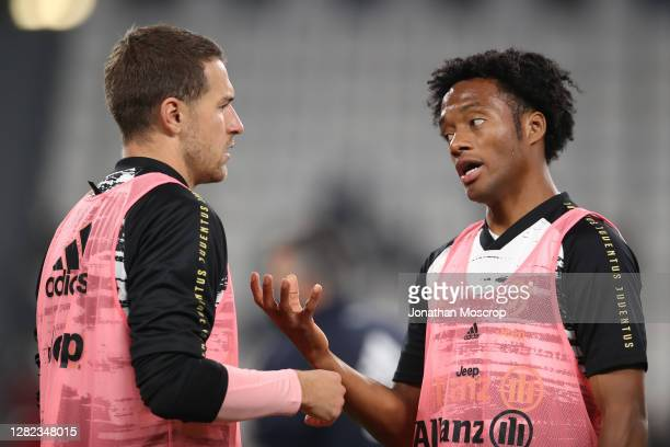 Aaron Ramsey of Juventus discusses with team mate Juan Cuadrado during the warm up prior to the Serie A match between Juventus and Hellas Verona FC...