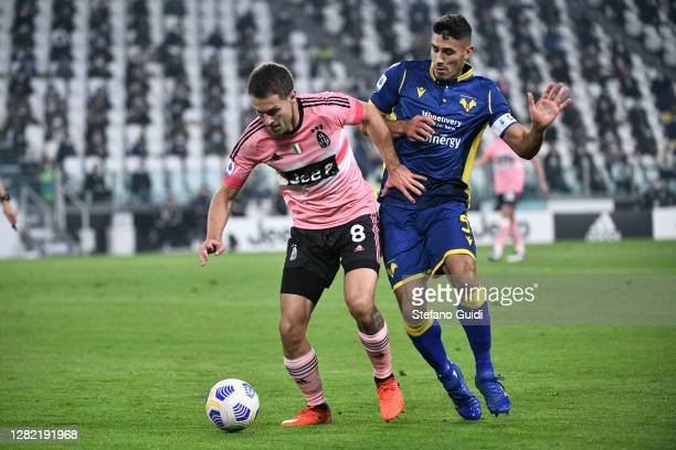 Aaron Ramsey of Juventus FC against Davide Faraoni of Hellas Verona Football Club during the Serie A match between Juventus and Hellas Verona FC at...