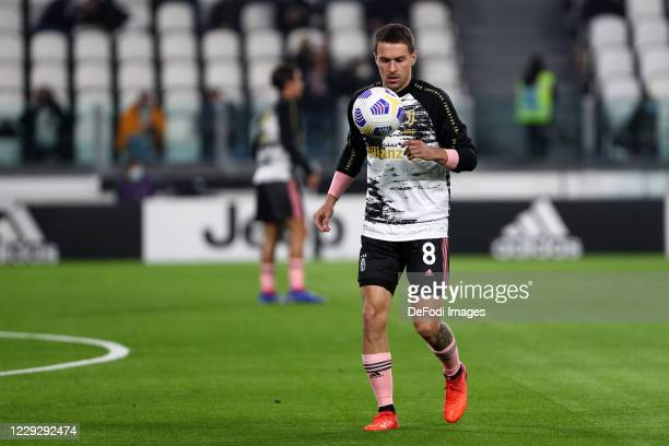 Aaron Ramsey of Juventus FC warms up prior to the Serie A match between Juventus and Hellas Verona FC at Allianz Stadium on October 25 2020 in Turin...
