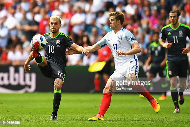 Aaron Ramsey of Wales and Eric Dier of England compete for the ball during the UEFA EURO 2016 Group B match between England and Wales at Stade...