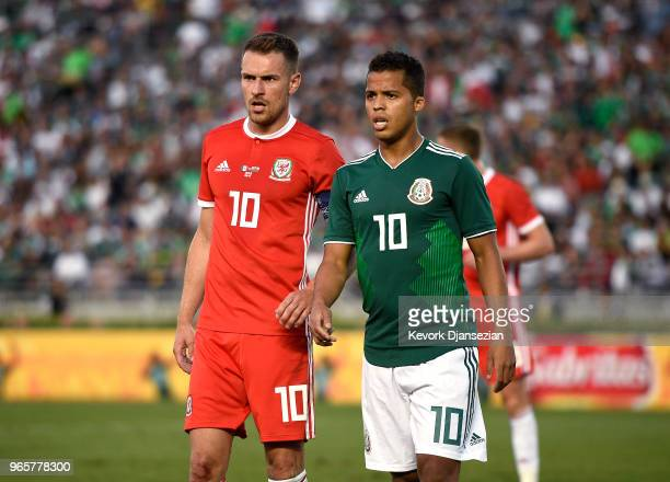 Aaron Ramsey of Wales and Giovani Dos Santos of Mexico during the second half of their friendly international soccer match at the Rose Bowl on May 28...