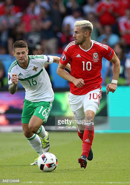 Aaron Ramsey of Wales and Oliver Norwood of Northern Ireland in action during the UEFA EURO 2016 round of 16 match between Wales and Northern Ireland...
