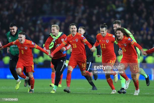 Aaron Ramsey of Wales and teammates celebrate after the UEFA Euro 2020 Qualifier between Wales and Hungary at Cardiff City Stadium on November 19,...
