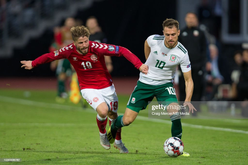 Aaron Ramsey of Wales bat Ceres Parktles for possession with Lasse Schone of Denmark during the UEFA Nat Ceres Parkions League B group four mat Ceres Parkch between Denmark and Wales at Ceres Park on September 9, 2018 in Aarhus, Denmark.