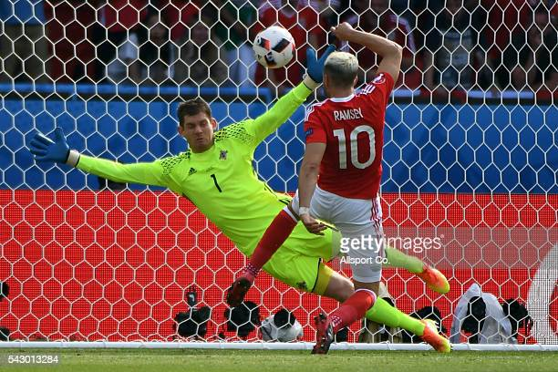 Aaron Ramsey of Wales beats Michael McGovern of Northern Ireland but was rules offside during the UEFA EURO 2016 round of 16 match between Wales and...