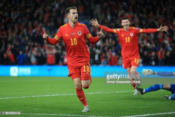 Aaron Ramsey of Wales celebrates after scoring their 1st goal during the UEFA Euro 2020 Qualifier between Wales and Hungary at Cardiff City Stadium...