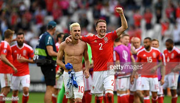 Aaron Ramsey of Wales celebrates his team's win with his team mate Chris Gunter after the UEFA EURO 2016 Group B match between Wales and Slovakia at...