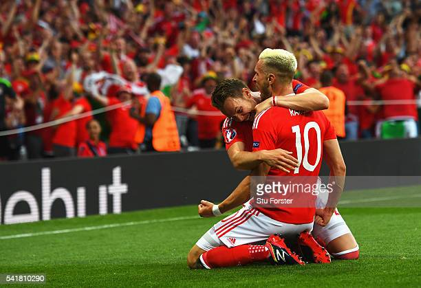 Aaron Ramsey of Wales celebrates scoring his team's first goal with his team mate James Chester during the UEFA EURO 2016 Group B match between...