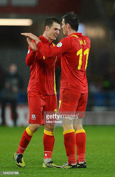 Aaron Ramsey of Wales celebrates with 2 goal hero Gareth Bale at the end of the FIFA 2014 World Cup Group A Qualifier between Wales and Scotland at...