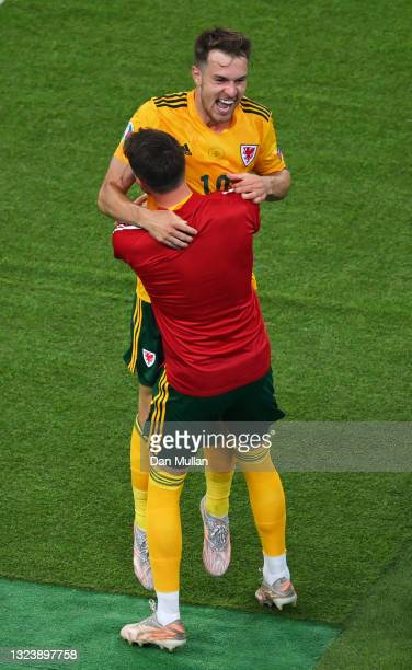 Aaron Ramsey of Wales celebrates with a team mate after scoring their side's first goal during the UEFA Euro 2020 Championship Group A match between...