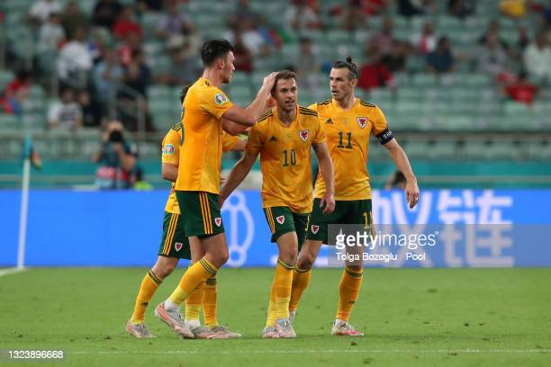 Aaron Ramsey of Wales celebrates with Kieffer Moore and Gareth Bale after scoring their side's first goal during the UEFA Euro 2020 Championship...