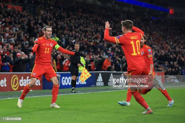 Aaron Ramsey of Wales celebrates with provider Gareth Bale of Wales after scoring their 1st goal during the UEFA Euro 2020 Qualifier between Wales...