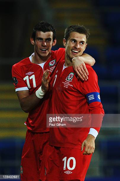 Aaron Ramsey of Wales celebrates with team mate Gareth Bale after scoring his sides second goal during the UEFA EURO 2012 group G qualifying match...