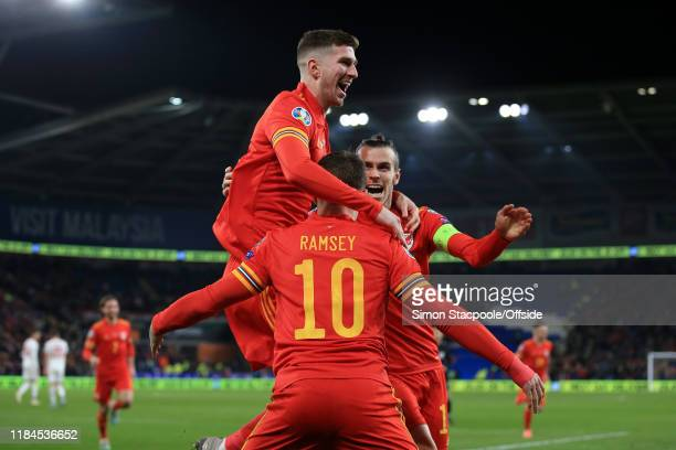 Aaron Ramsey of Wales celebrates with teammates Chris Mepham of Wales and Gareth Bale of Wales after scoring their 2nd goal during the UEFA Euro 2020...
