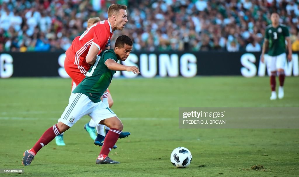 Aaron Ramsey of Wales (rear) collides with Giovani dos Santos of Mexico (front) during their international football friendly at the Rose Bowl in Pasadena, California on May 28, 2018 where the game ended 0-0.