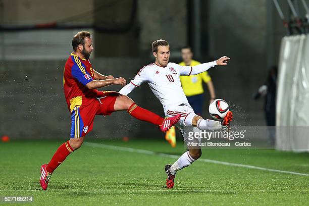 Aaron Ramsey of Wales duels for the ball with Josep Ayala of Andorra during the 2016 UEFA European Championship qualifying football match Group B...