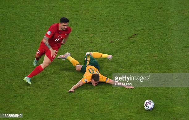 Aaron Ramsey of Wales is closed down by Ozan Tufan of Turkey during the UEFA Euro 2020 Championship Group A match between Turkey and Wales at Baku...