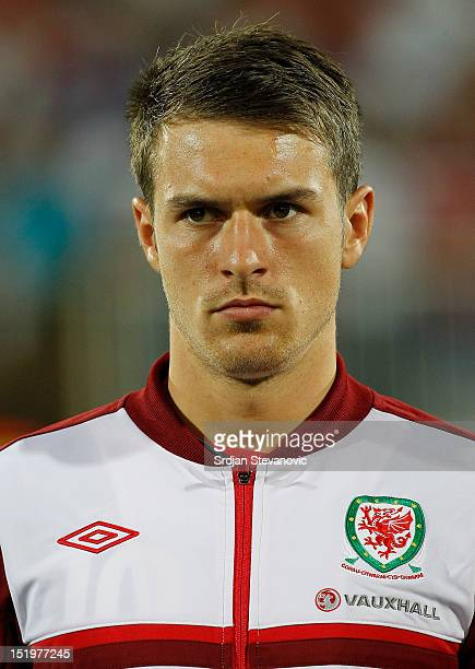 Aaron Ramsey of Wales listens to the national anthem prior to the FIFA 2014 World Cup Qualifier at stadium Karadjordje Park between Serbia and Wales...