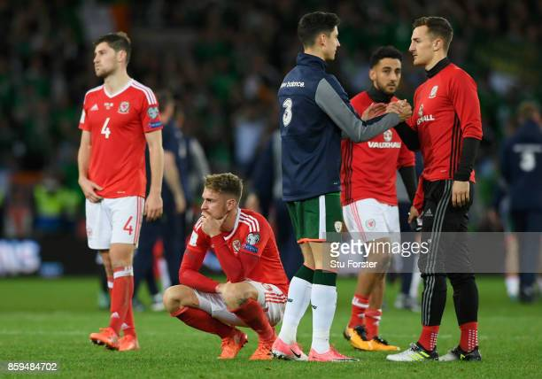 Aaron Ramsey of Wales looks dejected in defeat with team mates after the FIFA 2018 World Cup Group D Qualifier between Wales and Republic of Ireland...