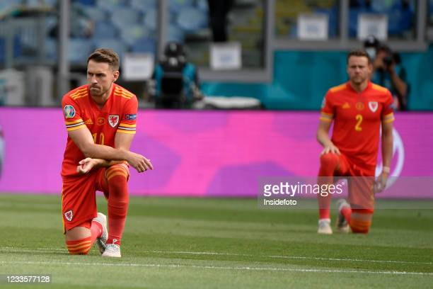 Aaron Ramsey of Wales on his knees prior to the Uefa Euro 2020 Group A football match between Italy and Wales. Italy won 1-0 over Wales. Both team...