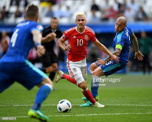 Aaron Ramsey of Wales races past Martin Skrtel of Slovakia during the UEFA EURO 2016 Group B match between Wales and Slovakia at Stade Matmut...