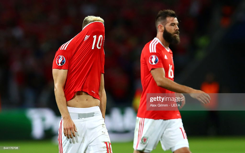 Aaron Ramsey (L) of Wales reacts after receiving an yelow card as he misses the next match during the UEFA EURO 2016 quarter final match between Wales and Belgium at Stade Pierre-Mauroy on July 1, 2016 in Lille, France.