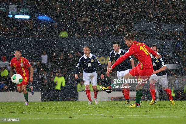 Aaron Ramsey of Wales scores his goal from the penalty spot during the FIFA 2014 World Cup Group A qualifying match between Scotland and Wales at...