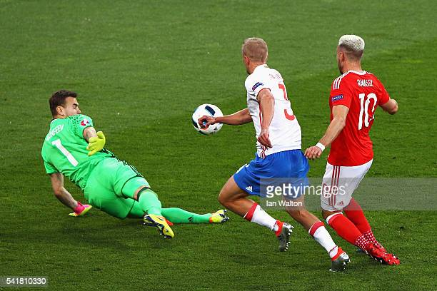 Aaron Ramsey of Wales scores the opening goal past Igor Akinfeev of Russia during the UEFA EURO 2016 Group B match between Russia and Wales at...