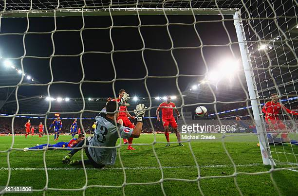 Aaron Ramsey of Wales shoots past goalkeeper Ferran Pol of Andorra to score their first goal during the UEFA EURO 2016 qualifying Group B match...