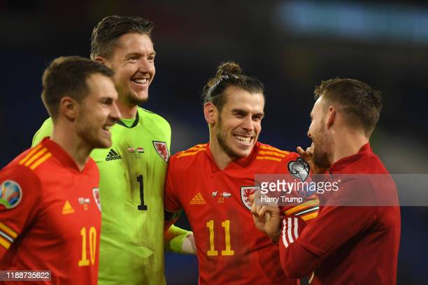 Aaron Ramsey of Wales , Wayne Hennessey of Wales , Gareth Bale of Wales and Chris Gunter of Wales celebrate after the final whistle during the UEFA...