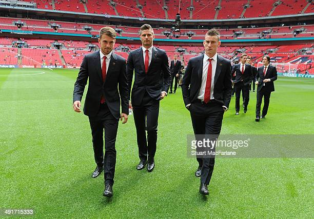 Aaron Ramsey Olivier Giroud and Laurent Koscielny of Arsenal before the FA Cup Final between Arsenal and Hull City at Wembley Stadium on May 17 2014...