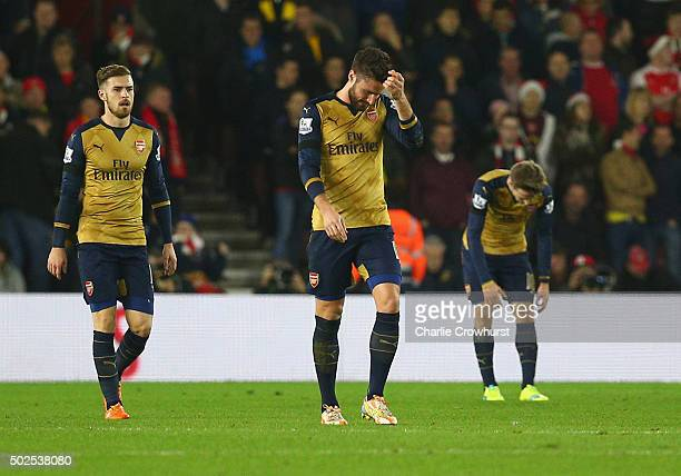 Aaron Ramsey Olivier Giroud and Nacho Monreal of Arsenal look dejected as Cuco Martina of Southampton scores their first goal during the Barclays...