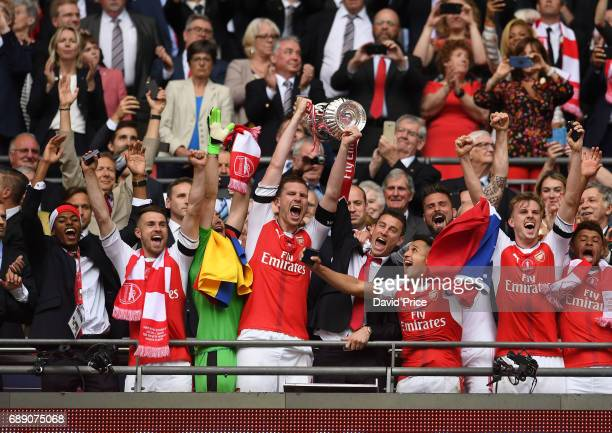 Aaron Ramsey Per Mertesacker Laurent Koscielny Alexis Sanchez and Rob Holding of Arsenal lift the FA Cup Trophy after the match between Arsenal and...