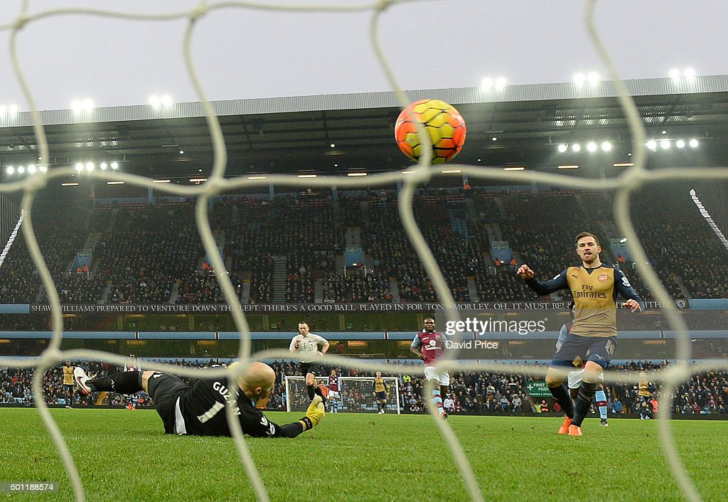 Aaron Ramsey scores Arsenal's 2nd goal as Brad Guzan of Villa looks on during the Barclays Premier League match between Aston Villa and Arsenal on 13th December, 2015 in Birmingham, England.