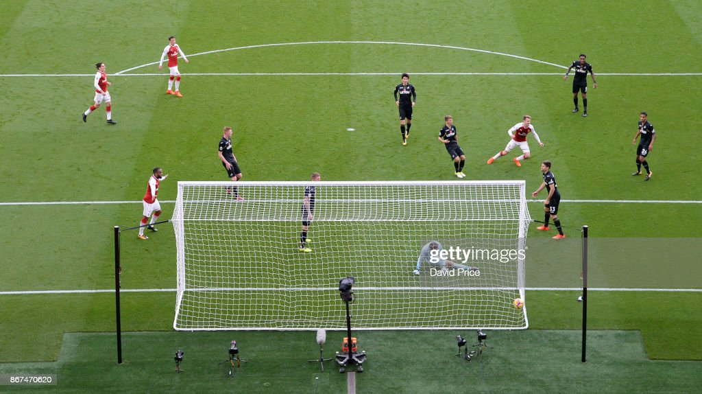 Aaron Ramsey (red shirt far right) scores Arsenal's 2nd goal during the Premier League match between Arsenal and Swansea City at Emirates Stadium on October 28, 2017 in London, England.