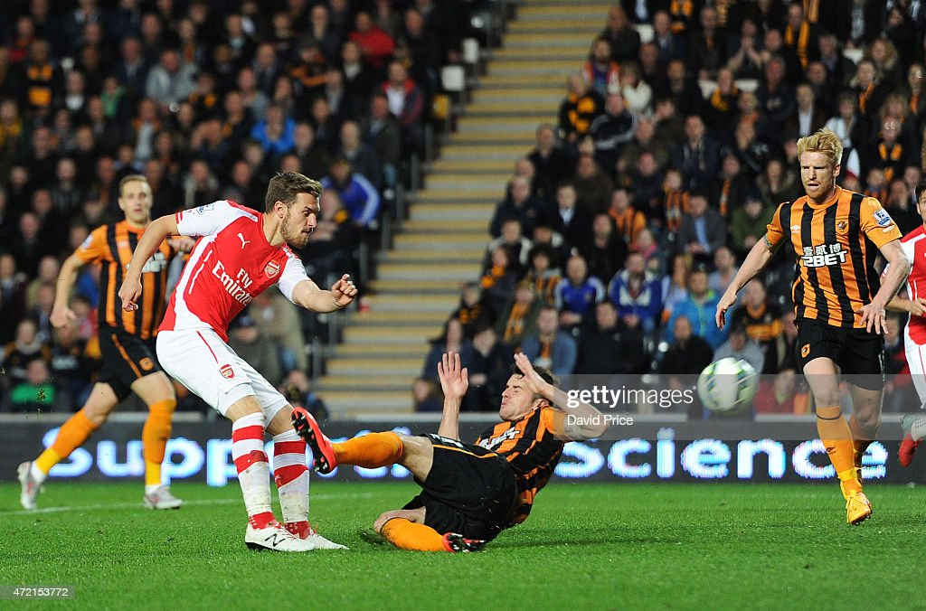 Aaron Ramsey scores Arsenal's 2nd goal under pressure from Robbie Brady of Hull during the match between Hull City and Arsenal at KC Stadium on May 4, 2015 in Hull, England.