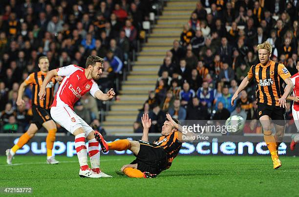Aaron Ramsey scores Arsenal's 2nd goal under pressure from Robbie Brady of Hull during the match between Hull City and Arsenal at KC Stadium on May 4...