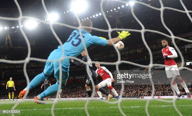Aaron Ramsey scores Arsenal's 3rd goal his 2nd past Igor Akinfeev of CSKA during the UEFA Europa League quarter final leg one match between Arsenal...