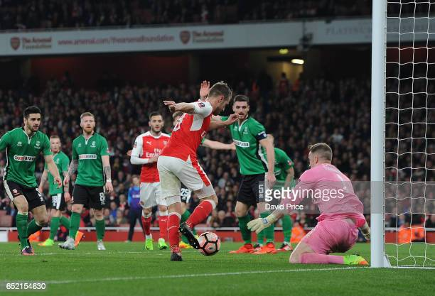 Aaron Ramsey scores Arsenal's 5th goal past Paul Farman of Lincoln during the match between Arsenal and Lincoln City at Emirates Stadium on March 11...